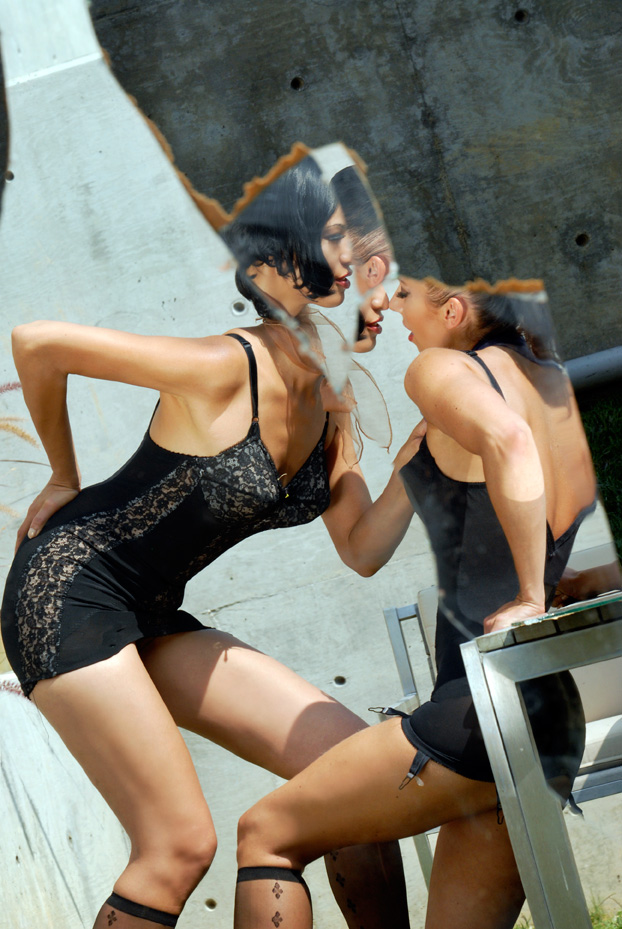 Women with black lingerie in mirror.