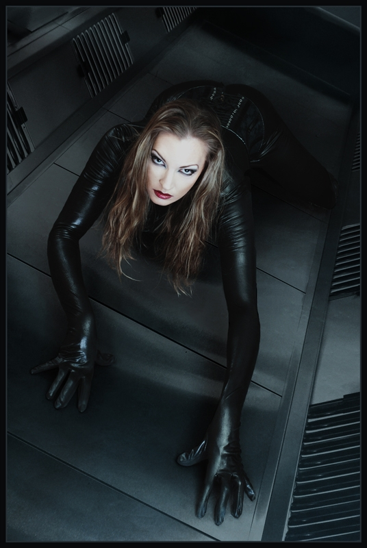 Black latex woman. (c) Martin Black