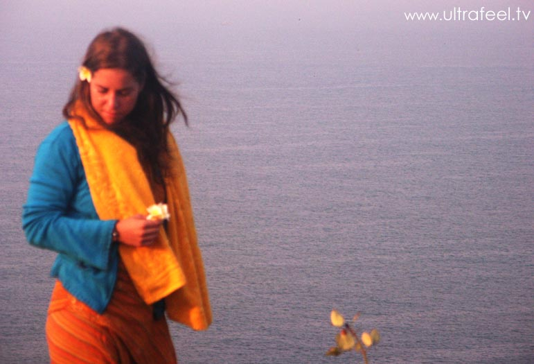Girl with flower in front of Arambol sea, Goa
