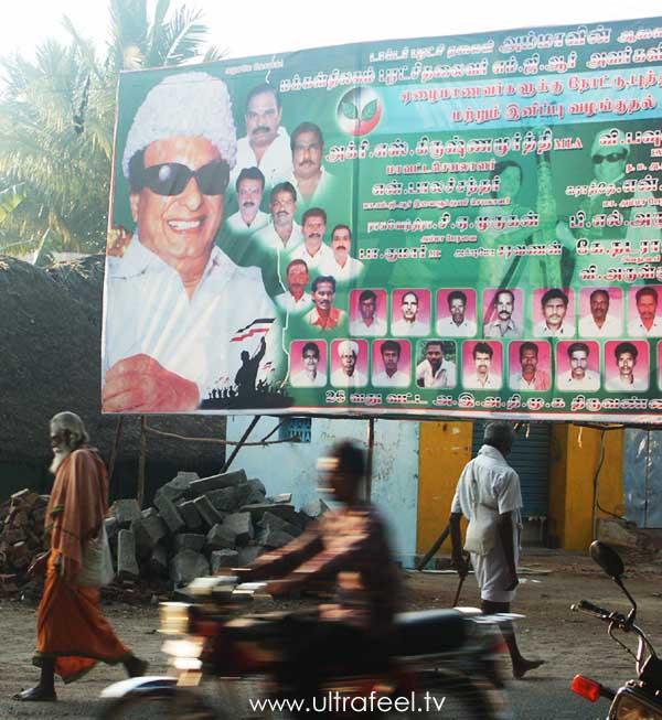 Politician/Politics advertisement at a street with Sadhu (holy man) in Tiruvannamalai, India