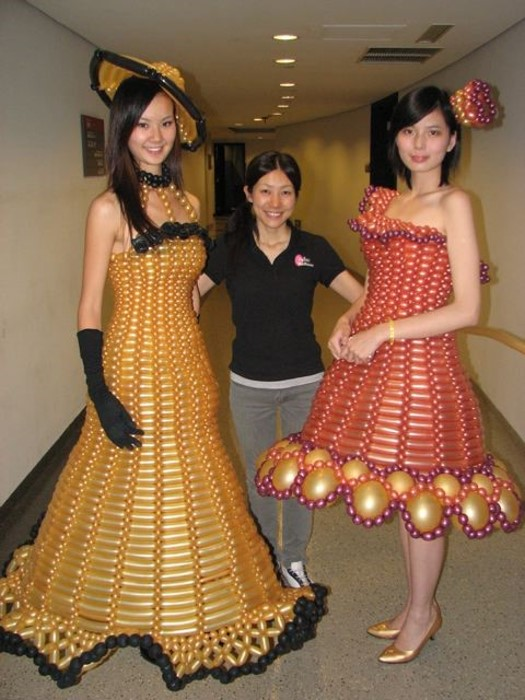 Women with balloon dresses.