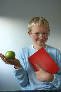 Boy with apple and book. (Sxc.hu)