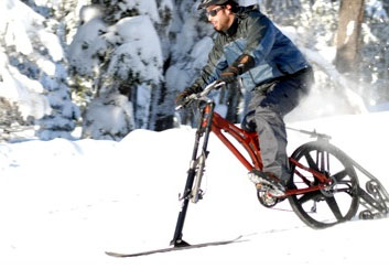 Ktrak ski bike. Man riding the ktrakcycle.