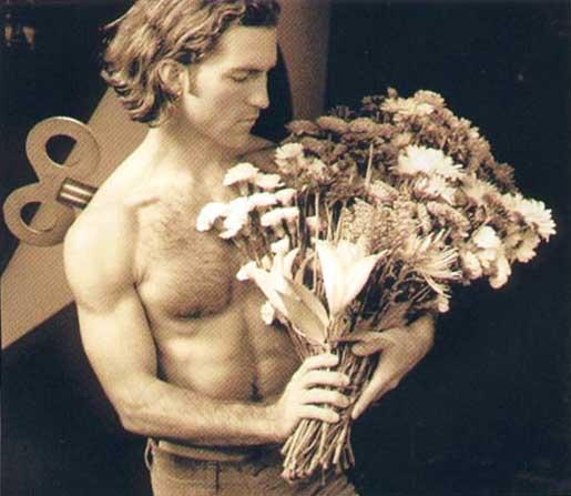 Man with flowers. Mann mit blumen.