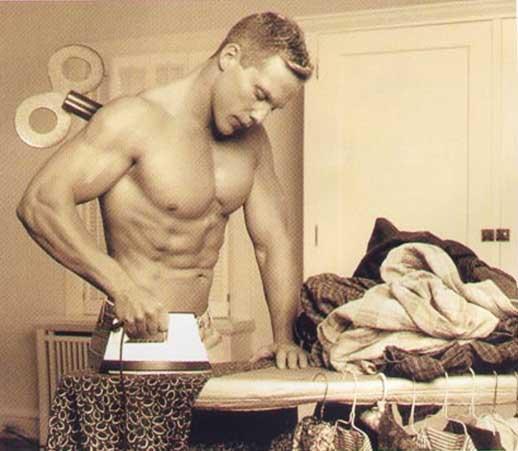 Man ironing clothes. Mann am buegeln.