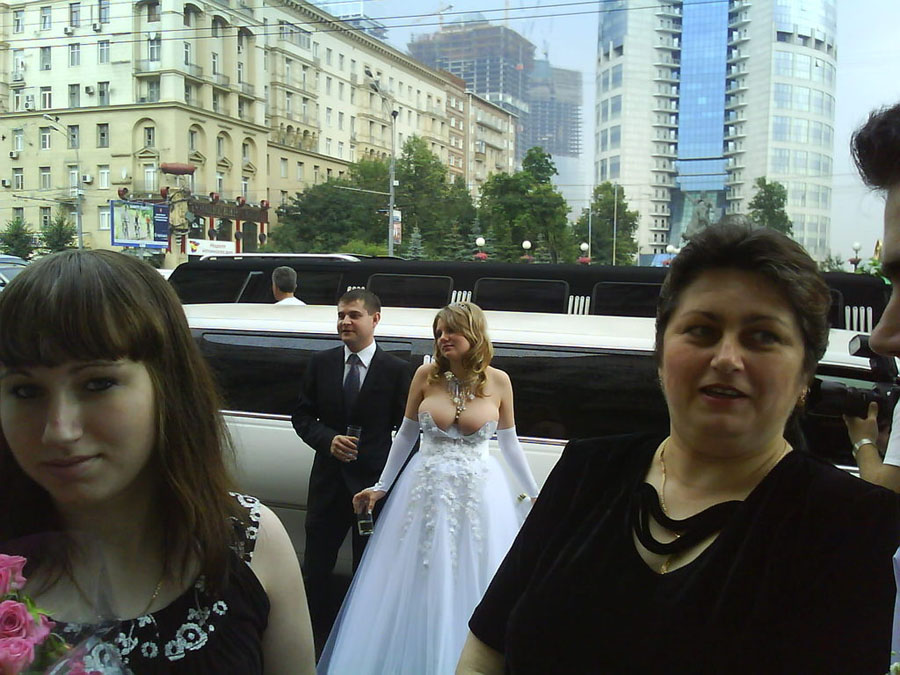 Russian bride with tits nearly falling out.
