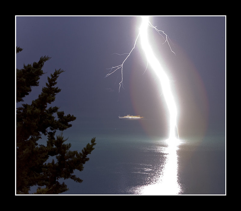 Lightning in a lake. (c) Thierry Galeuchet