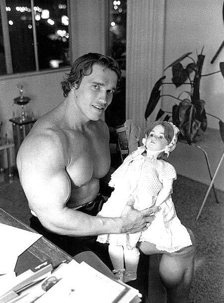 Arnold Schwarzenegger with puppet.