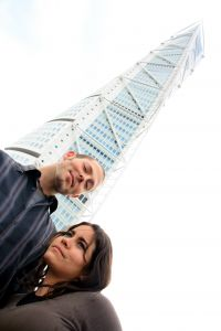 Couple in front of tower.