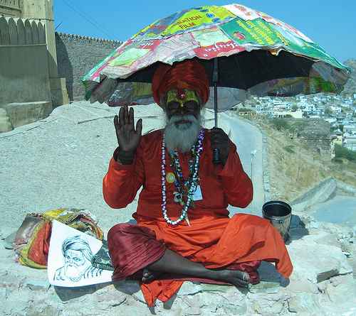 Indian guru with umbrella.