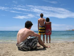 Couple and lonely boy at the beach...Jealousy!