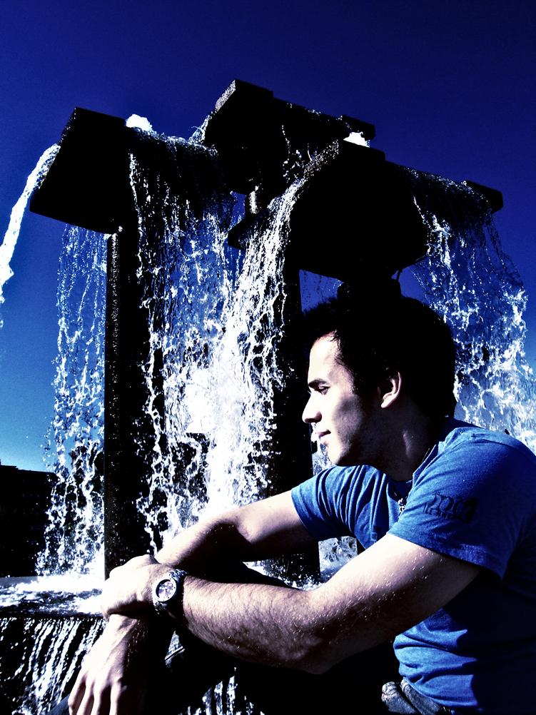 Man behind a water fountain.