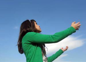 Woman looking to the sky. (Sxc.hu)