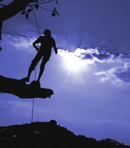 Man climbing blue sun. (Sxc.hu)