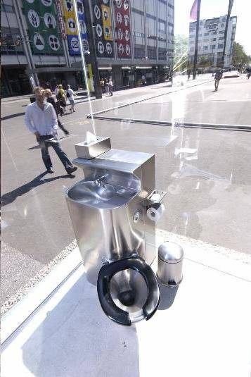 Monica Bonvicini's public glass transparent toilet.