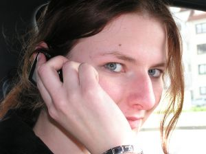 Woman calling on mobile phone.